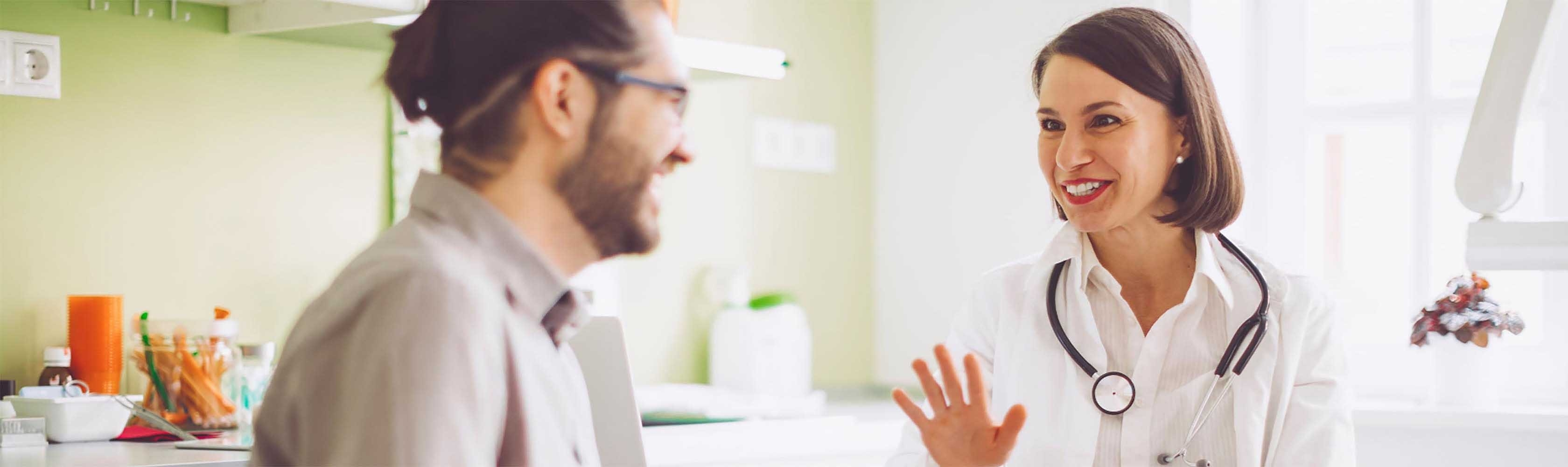 Doctor and patient talk to each other during a visit